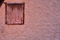 Closed Window and detail of a traditional French wall. (home)  at night in Vic-sur-Cere, France Royalty Free Stock Images