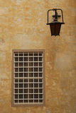 Closed window with a grating near a lantern in Mdina Royalty Free Stock Photo