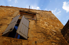 The closed window of the house and Royalty Free Stock Photo