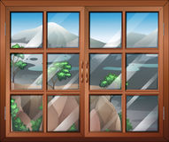 A closed window near the cliff Stock Photos