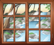 A closed window near the waterfall Royalty Free Stock Photo