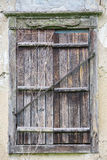 Closed window of an old house.  Royalty Free Stock Photo
