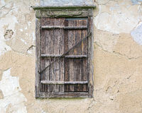 Closed window of an old house.  Royalty Free Stock Images