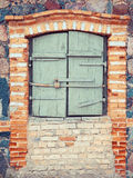 Closed  window of old  house. Closed rustic window of old  house Royalty Free Stock Images