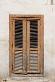 Closed window with old shutter Royalty Free Stock Images