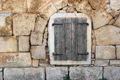 Closed window at the old stone house. Closed window at the old Mediterranean stone house Royalty Free Stock Photography
