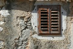 Closed window at the old stone house. Closed window at the old Mediterranean stone house Stock Photography
