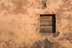 Closed window on the old wall. Stock Photos