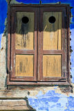 Closed window with old wood shutters Royalty Free Stock Image