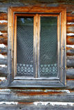 The closed window of the old wooden house Royalty Free Stock Image