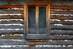 The closed window of the old wooden house Stock Photos