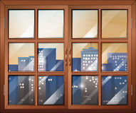 A closed window overlooking the city buildings Stock Images