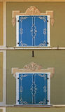 Closed window shutters with painted framing Royalty Free Stock Photos