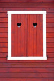 Closed window shutters, red color, Royalty Free Stock Photo