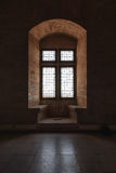 Closed window with stained glass in the Papal palace in Avignon. France stock photo