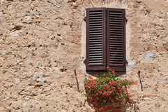 Closed window on a stone wall Stock Photography