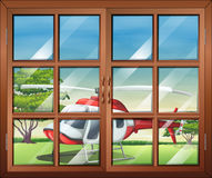 A closed window with a view of the chopper outside stock illustration