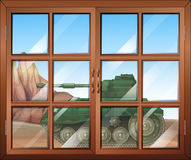 A closed window with a view of the military tanker outdoor Royalty Free Stock Photos