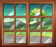 A closed window with a view of the road Stock Images
