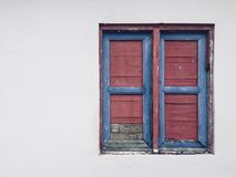 Closed window, vintage wooden shutter isolated on white wall bui Stock Photography
