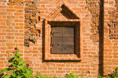 Closed window on a wall of old manor Royalty Free Stock Photos