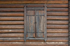 Closed window on wooden house. Closed window on rural wooden house Royalty Free Stock Photos