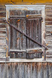 Closed window in a wooden house Royalty Free Stock Image