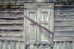 Closed window on the wooden wall Royalty Free Stock Photography