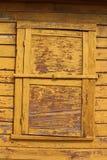 Closed window. Closed yellow window and wall stock photo