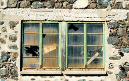 Closed windows with  broken glass Stock Photos