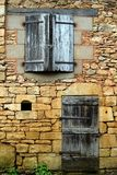 The closed windows, doors and shutters (2). The closed windows, doors and shutters in an old wall, small village in France (2 Stock Photos