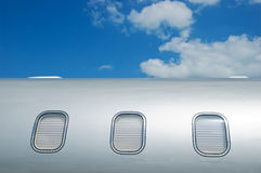 Closed windows on gray metallic corporate jet Stock Photography