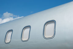 Closed windows on gray metallic corporate jet Royalty Free Stock Image