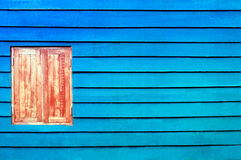 Closed windows on rural blue wooden house. Outdoor Royalty Free Stock Image