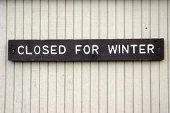 Closed for winter. Sign on a white wooden wall Stock Photo