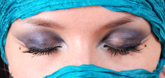 Closed woman's eyes with east make-up Stock Photo