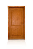 Closed wood door isolated royalty free stock photography