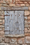 Closed Wood window on stone house.  Royalty Free Stock Photography
