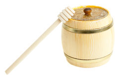 Closed wooden barrel and wooden stick for honey Stock Image