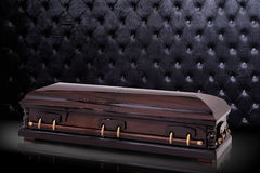 Closed wooden brown sarcophagus isolated on gray luxury background. casket, coffin on royal background. Stock Photography