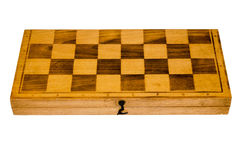 Closed wooden chess board isolated on white background Royalty Free Stock Photos