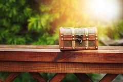 Closed wooden chest box outdoors in nature Royalty Free Stock Images