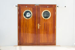 Closed wooden dobule doors with brass fittings Royalty Free Stock Photography