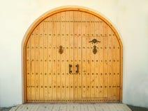 Closed wooden door in daytime Stock Images