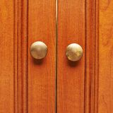 Closed wooden door fragment. With two handles Royalty Free Stock Photos