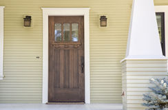 Closed wooden door of a home Stock Image