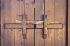 Closed wooden door with locking bar , vintage Royalty Free Stock Photo