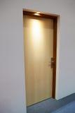 Closed wooden door in low light Royalty Free Stock Image