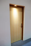 Closed wooden door in low light Royalty Free Stock Photography
