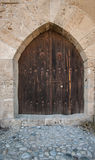 Closed wooden door of medieval fortress Royalty Free Stock Photography